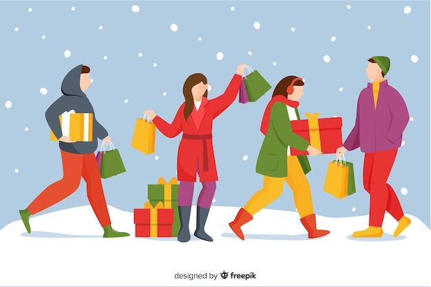 Personnes qui achètent des cadeaux de noël en plein air