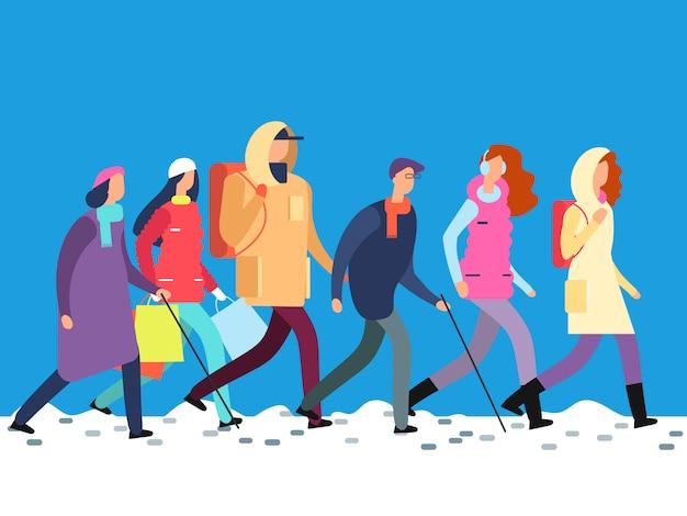 Personnes en vêtements d'hiver cartoon homme et femme, adolescents marchant en saison froide