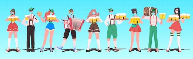 Personnes en vêtements traditionnels célébrant la fête de la bière oktoberfest