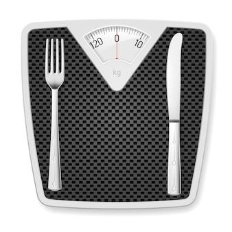 Pèse-personne avec fourchette et couteau.