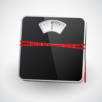 Un pèse-personne avec un ruban à mesurer.