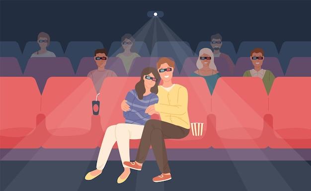 Petit ami et petite amie assis dans un cinéma stéréoscopique ou une salle de cinéma