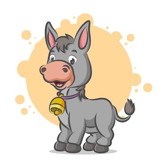 Petit âne utilisant un collier cloche et souriant avec un visage heureux