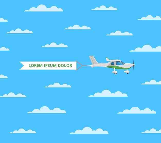 Petit avion à vis avec bannière dans le ciel