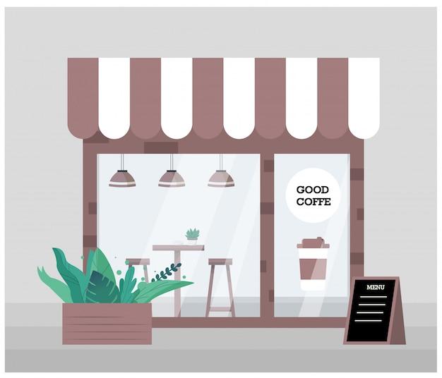 Le petit commerce est un café dans un intérieur écologique, avec une porte d'entrée, une grande vitrine et du verre.