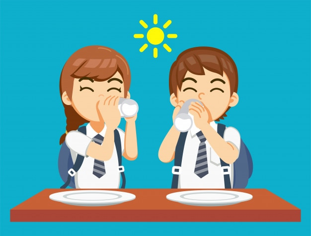 Petit déjeuner et boire du lait avant d'aller à l'école.