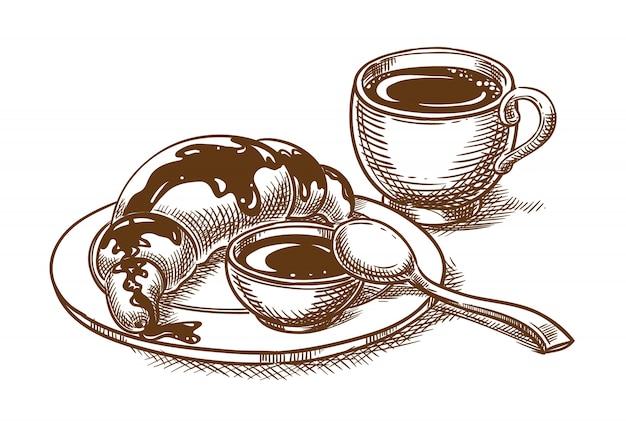 Petit-déjeuner avec une tasse de café et un croissant