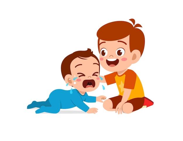 Un petit garçon mignon essaie de réconforter son petit frère qui pleure