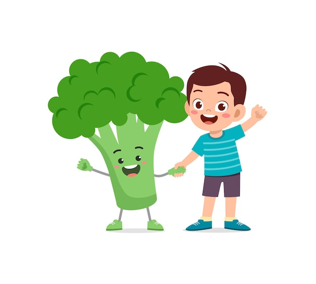 Le petit garçon mignon se tient avec le caractère de brocoli