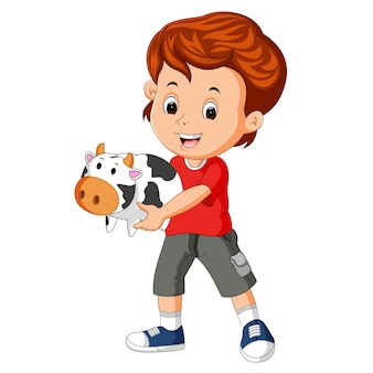 Petit garçon tenant la banque de vache