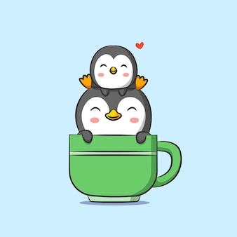 Petit et grand pingouin assis sur une tasse de thé avec une couleur verte