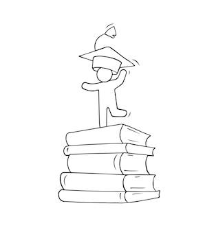 Le petit homme célèbre l'obtention du diplôme.