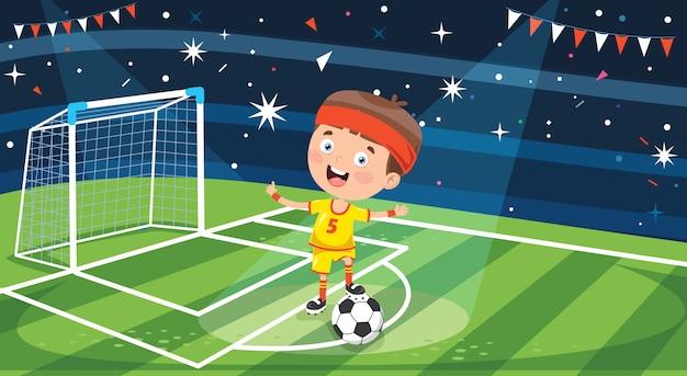 Petit joueur de football posant avec ballon