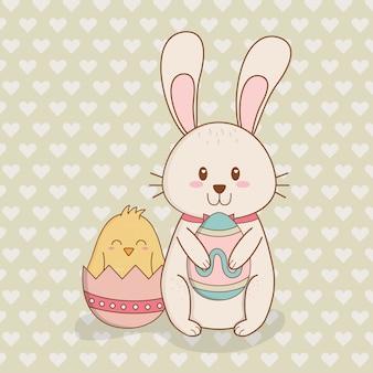 Petit lapin et poussin à l'oeuf peint personnages de pâques
