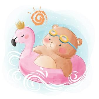 Petit ours sur les flotteurs flamingo