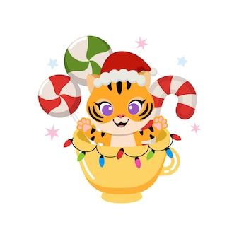 Le petit tigre mignon célèbre noël dans un verre décoré