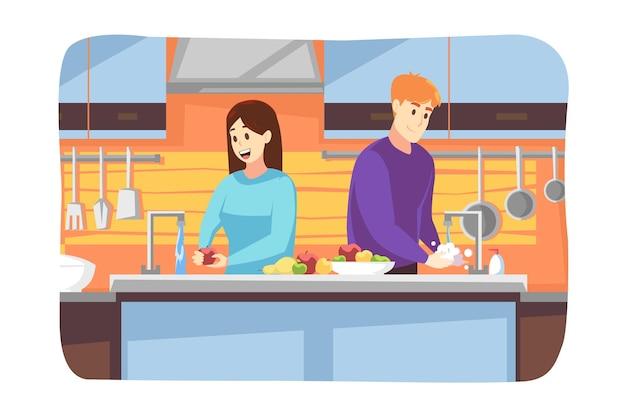 Petite amie femme se lave les mains de son petit ami homme lavant des fruits ensemble à la maison en quarantaine