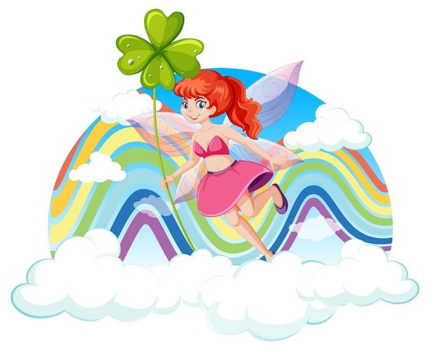 Petite fée tenant une feuille de trèfle dans le ciel avec arc-en-ciel