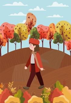 Petite fille avec costume d'automne dans le personnage du parc