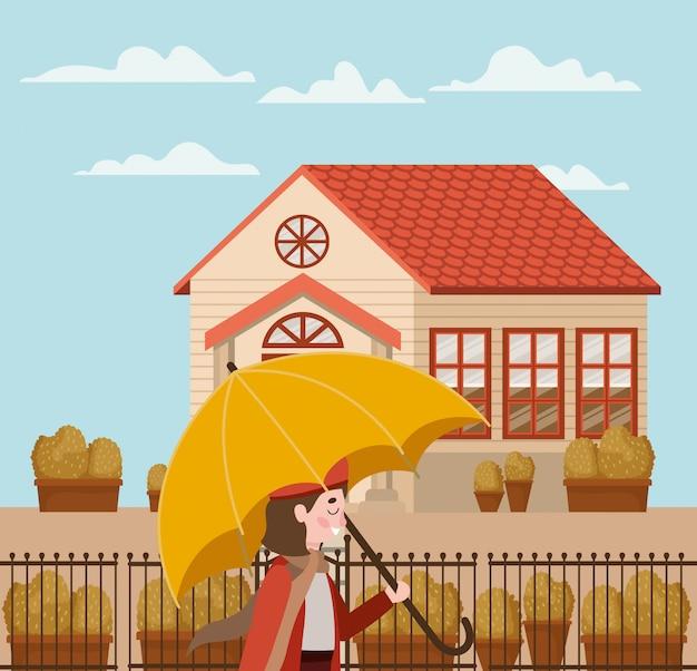 Petite fille en costume d'automne dans le personnage de la ville