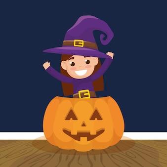 Petite fille avec déguisement de sorcière et citrouille