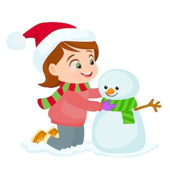 Petite fille faisant un bonhomme de neige