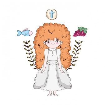 Petite fille et icônes dans la célébration de la première communion