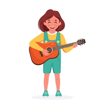 Petite fille jouant de la guitare enfant jouant d'un instrument de musique
