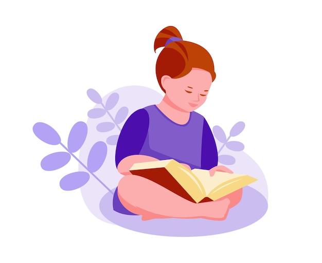 Petite fille lit un livre dans la nature. plantes, feuilles.