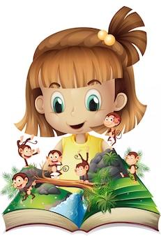 Petite fille et livre de singes dans la jungle
