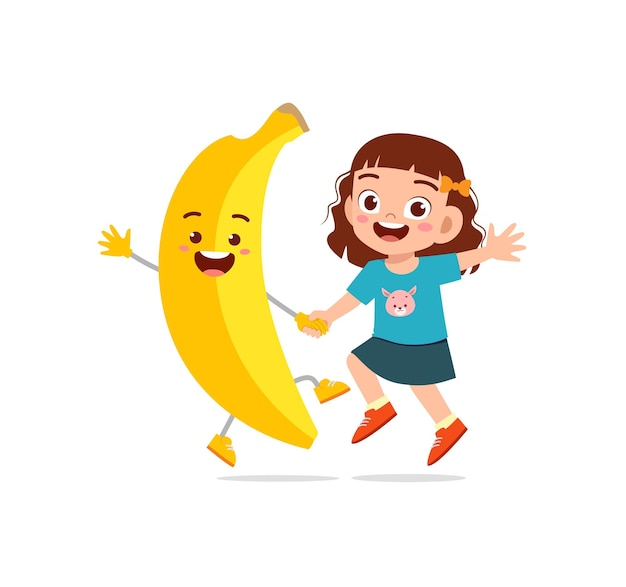 La petite fille mignonne se tient avec le caractère de banane
