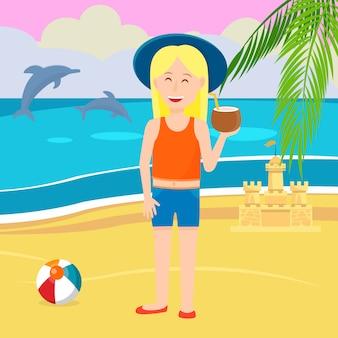 Petite fille à la noix de coco sur fond de côte de la mer.
