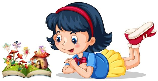 Petite fille regardant des fées dans le livre
