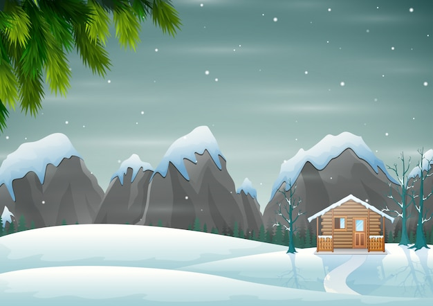 Une petite maison en bois sur la colline enneigée