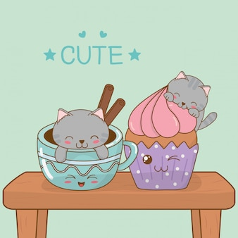 Petits chats mignons avec des tasses à café de caractères kawaii