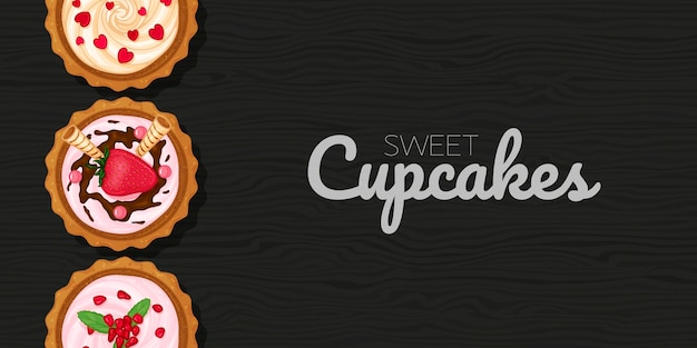 Petits gâteaux sucrés sur fond noir en bois