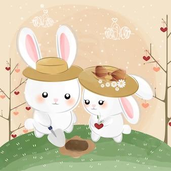 Petits lapins mignons avec des graines d'amour
