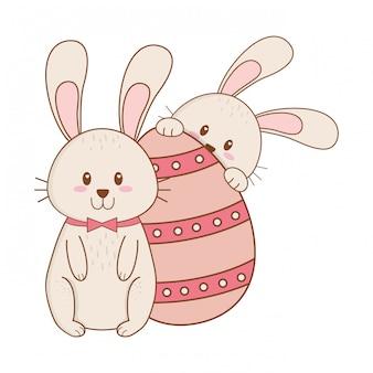 Petits lapins à l'oeuf peint personnage de pâques