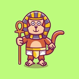 Pharaon singe mignon portant un bâton