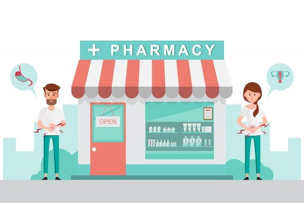 Pharmacie avec homme et femme devant la pharmacie