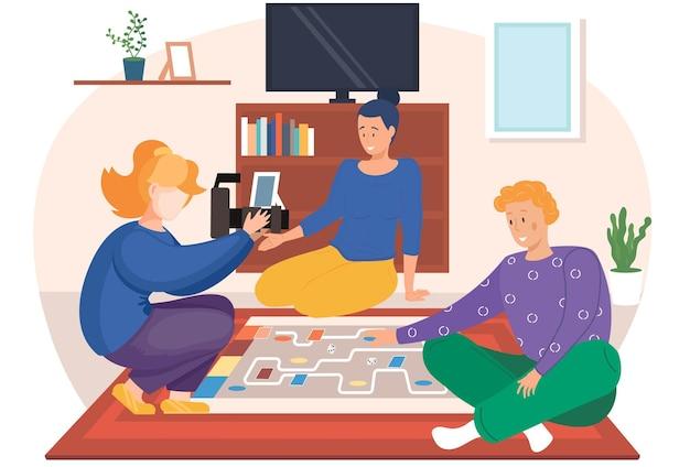Le photographe prend des photos d'amis jouant à un jeu dans un salon confortable