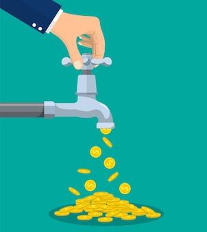 Les pièces d'or tombent du robinet en métal
