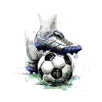 Pieds de bande de roulement de joueur de football sur un ballon de football pour le coup d'envoi sur un fond blanc