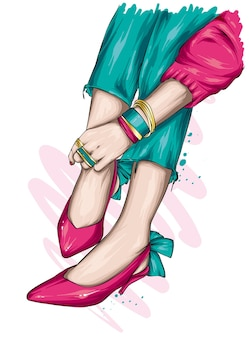 Pieds féminins dans des chaussures élégantes