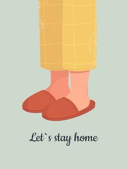 Pieds humains dans des pantoufles confortables et texte restons à la maison.