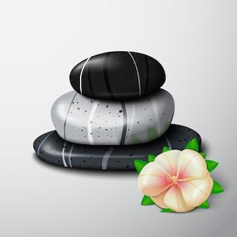 Pierres de spa avec une fleur tropicale