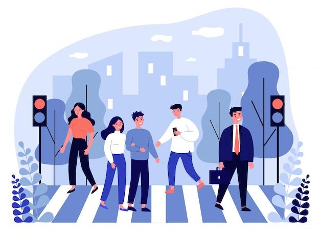 Piétons traversant la rue de la ville