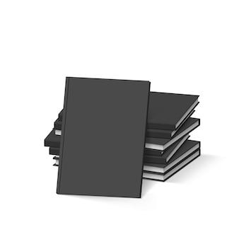 Pile de livres noirs vierges sur blanc. modèle de maquette