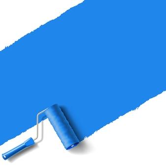 Pinceau à rouleau avec mur de peinture bleue