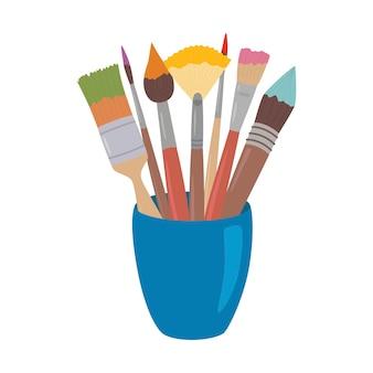Pinceaux avec de la peinture colorée dans une tasse.